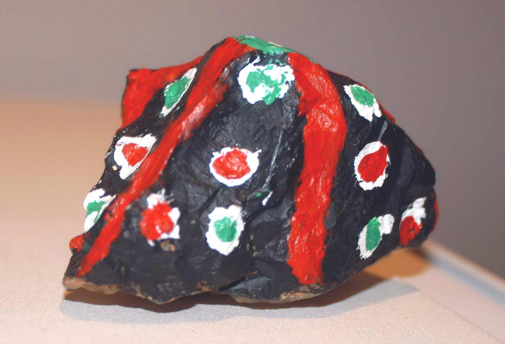 Painted quartz rock with red stripes