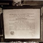 Holding her diploma from Columbia University