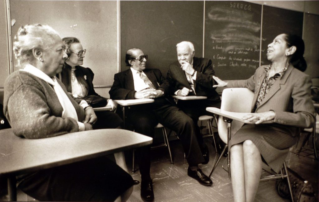 Former students reminisce in Dr. McAllister's classroom at Miner Teachers College