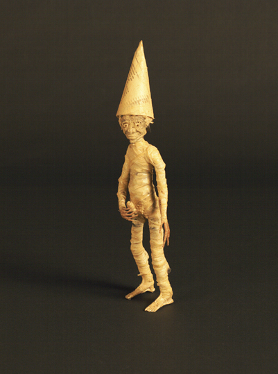 Figure with Dunce Hat