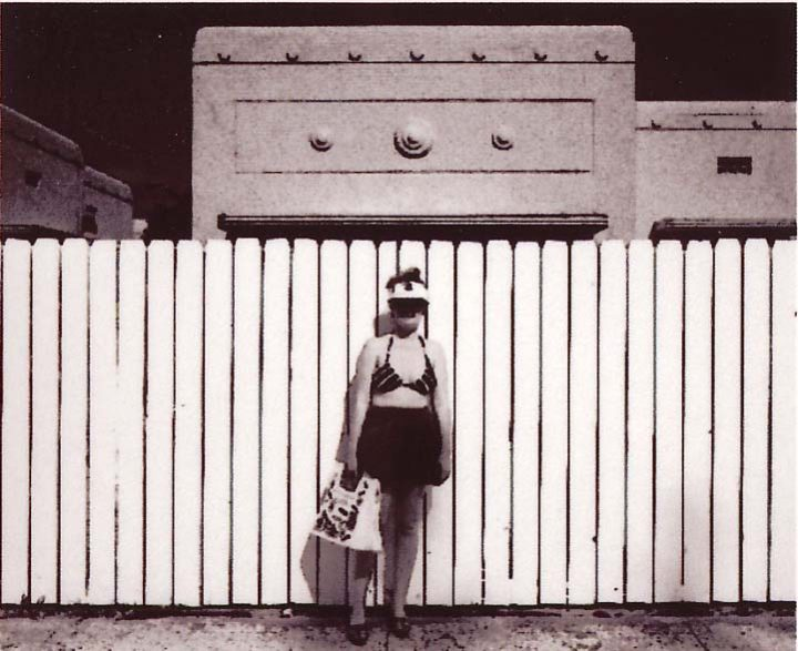 Woman and Fence